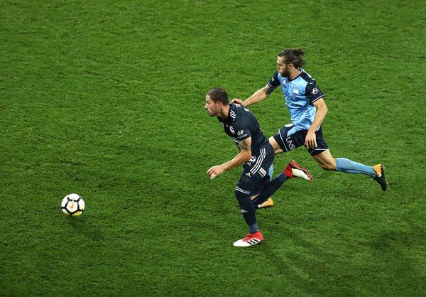 James Troisi Photos - James Troisi of the Victory is chased by Josh Brillante of Sydney FC during the round 18 A-League match between Melbourne Victory and Sydney FC at AAMI Park on January 26, 2018 in Melbourne, Australia. - A-League Rd 18 - Melbourne v Sydney