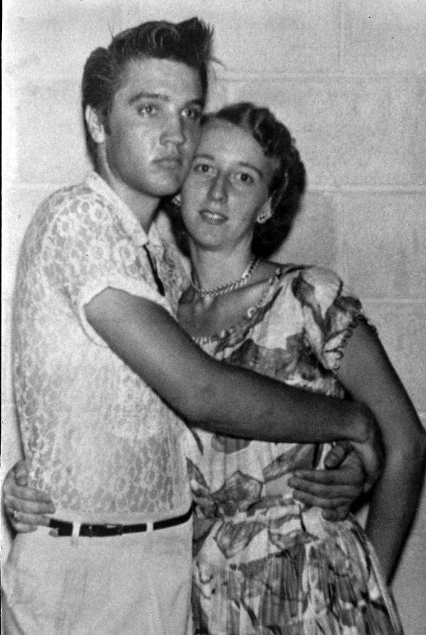 Elvis Presley poses with a fan after the Gator Bowl (1956).   Florida Memory