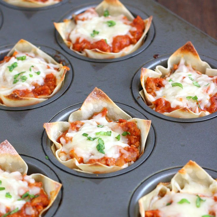 Muffin Tin Mini Lasagnas Recipe with ground turkey, onion, mushrooms, salt, pepper, tomato sauce, garlic cloves, dried oregano, red pepper flakes, dried basil, wonton wrappers, part-skim mozzarella cheese