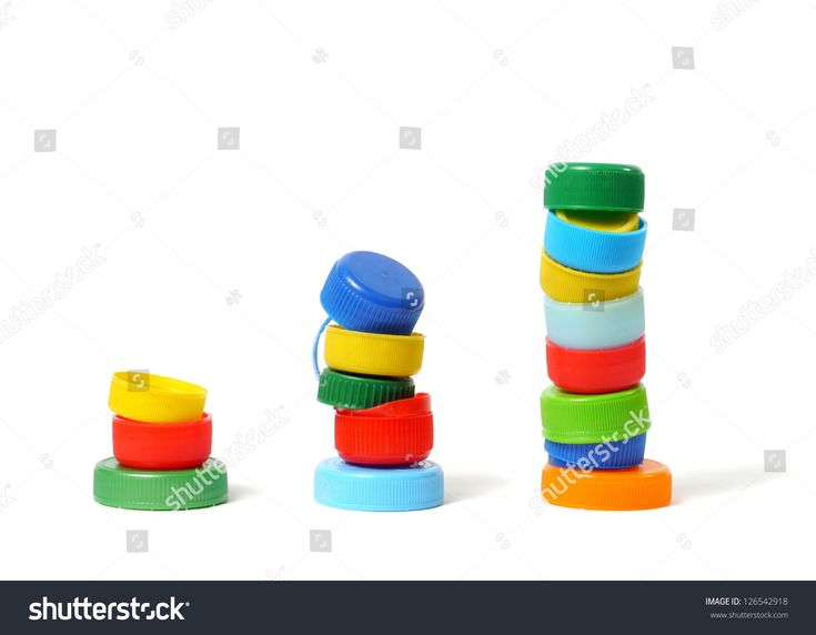 Stacks made from bottle caps on white background