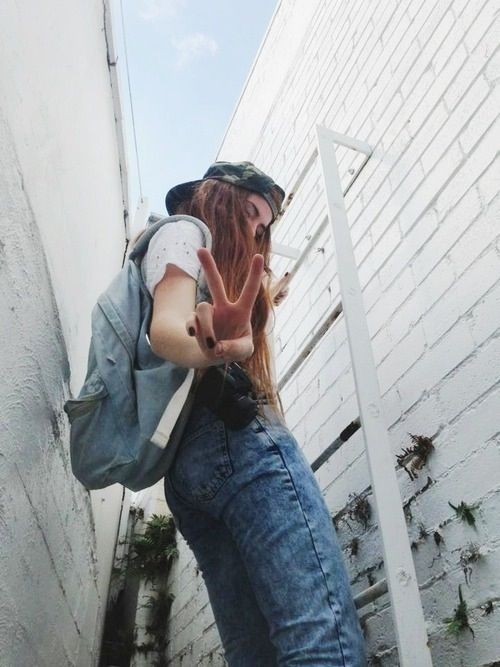Jeans and a backpack.