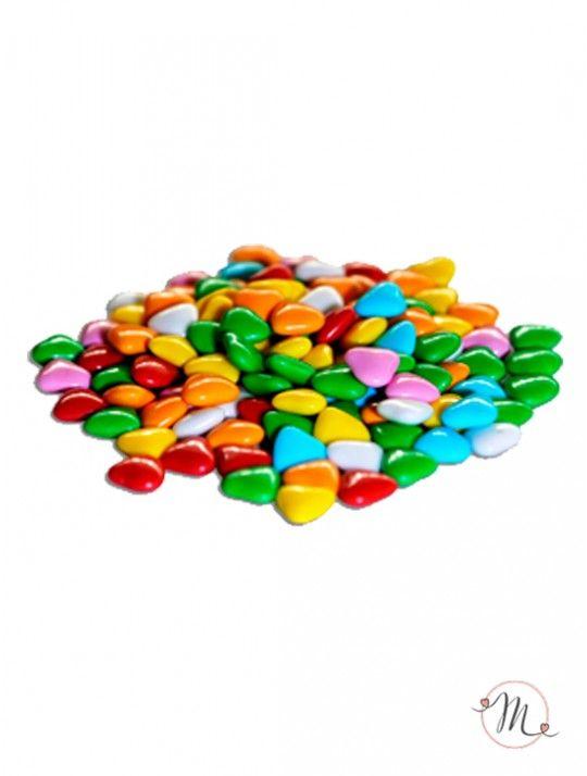 Confetti Maxtris Cuoricini multicolor. Questi confetti Maxtris Cuoricini multicolor hanno al loro interno un'anima di cioccolato fondente, rivestita da un sottile strato di zucchero. Confezione da 1kg. Colore: misto. L'unione tra colore e gusto li rende adatti alle giornate gioiose come quelle dedicate a matrimoni, anniversari e feste di fidanzamento. In #promozione #confettata #confetti #matrimonio #weddingday #ricevimento #maxtris #wedding #sconti