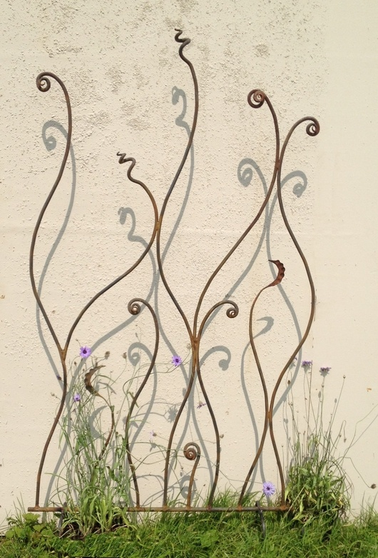 rusty metal trellis/screen twisted metal fern