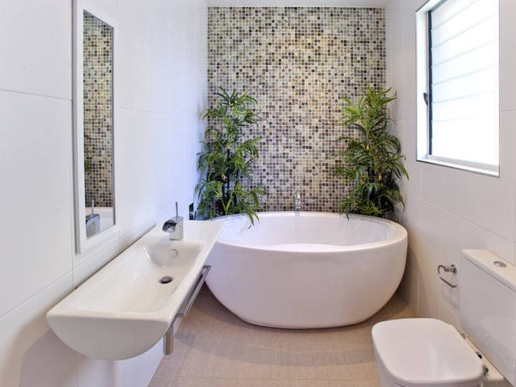 A small narrow space bathroom with round free standing for Free bathroom designs