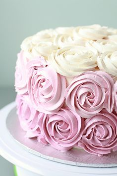 Rose-piped Italian meringue buttercream. Now, That's a cake!  Marzipan frosting? GROSS! I prefer chewing gum without cake... If I wanted a beautiful sculpture, I would not have it made out of cake!!!!! Stop The Madness!!!!!