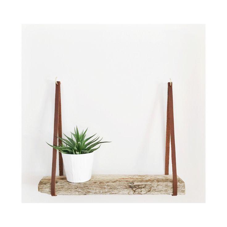 Minimalist Leather strap shelf.