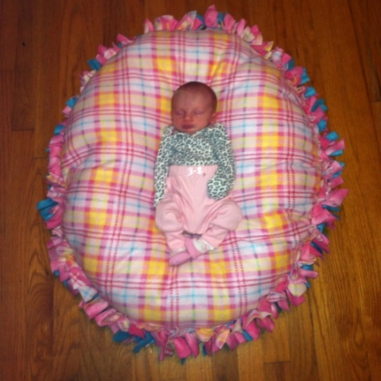 No-sew floor pillow pouf, made just like a tie fleece blanket but stuffed with poly-fil.