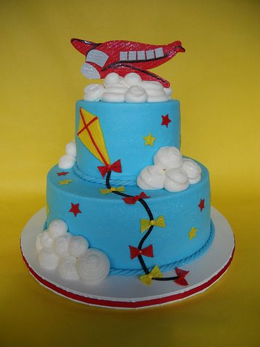 Blue, Red & Yellow Kite Cake with Airplane Topper