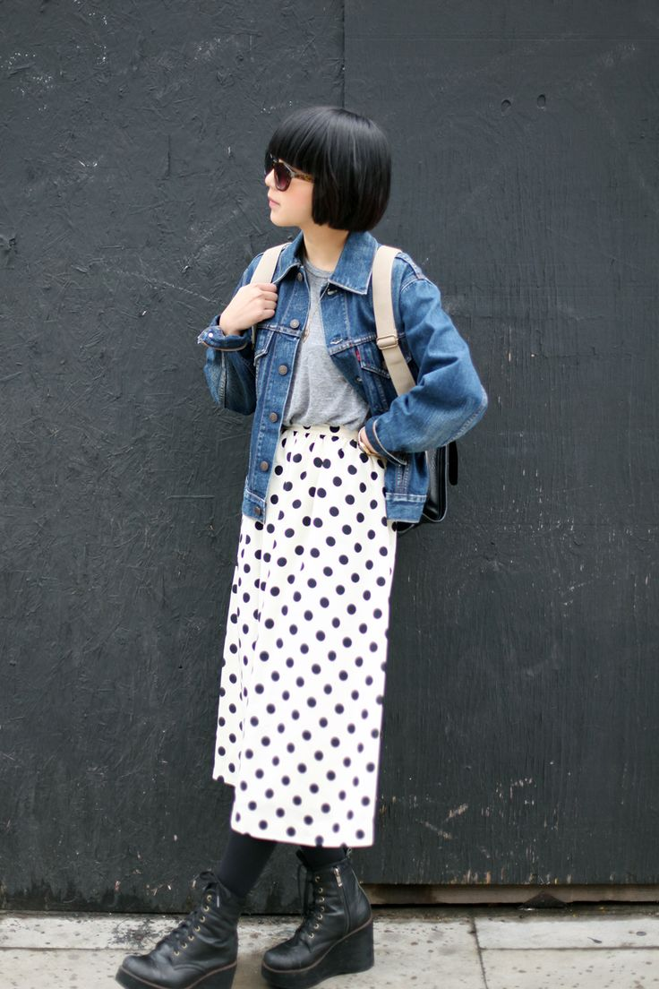 long polka dot white skirt, jeans jacket, grey t-shirt, backpack, black platforms