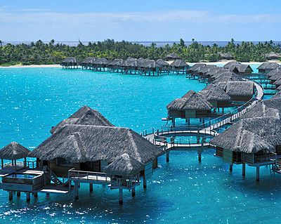 Could it get more iconic than this? Honeymooners can stay in an overwater bungalow that is picture perfect!