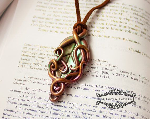 12 best elven jewelry elvish lord of the rings jewelry celtic beautiful elven pendant necklace hand sculpted from polymer clay and finished with iridescent mica powders the pendant hangs from a genuine suede leather aloadofball Gallery