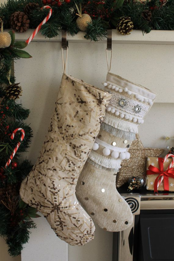 Festive stocking made from a sequin embroidered linen fabric. The fabric is a natural cream colour with gold sequins embellished on top in a snowflake design.  Fully lined with a beige cotton fabric and finished with a linen fabric hanging loop.  Length : 37 cm Width : 16.5 cm (across cuff)  25 cm (across foot)