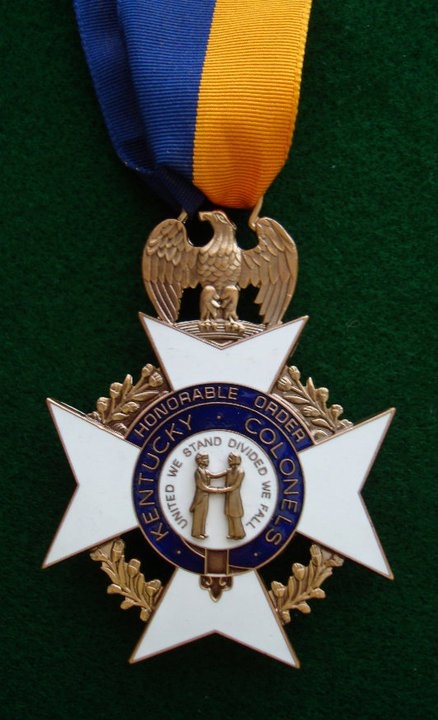 """The Golden Eagle Medallion was designed in 1931 by Colonel R. H. Ziehm, who put together the first Kentucky Colonel organization. It was approved as part of the """"official"""" insignia package during the May 2, 1931 organizational meeting of THE KENTUCKY COLONELS. It is awarded as part of the Legion of Merit."""