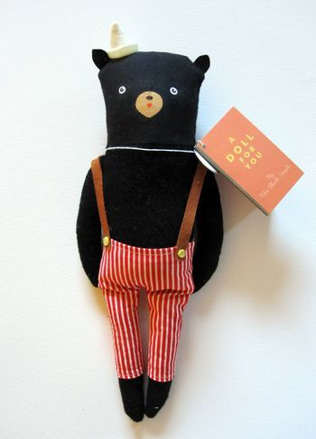 This stuffed animal bear is so cute. I love his suspenders. I want to make one. I wonder if it would be that hard to do.