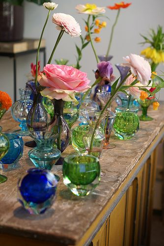 colored glass and flowers....this is what i want to do with all my wedding vases....
