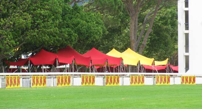 Red and yellow stretch tents at the 2010 J&B Met in South Africa. Its variety of applications make stretch tents the ideal tent for outdoor events.