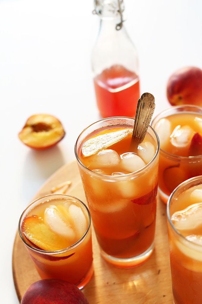 Incredibly simple 4-ingredient peach iced tea infused with real peaches and peach simple syrup. The perfect summer drink to sip by the pool.
