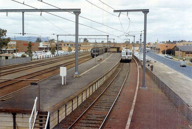 Glen Waverley station, terminus of line, not a high rise building in sight!  Woolworths supermarket to the left (since moved to the Glen shopping centre and Dan Murphy's is on that site today).  1975.
