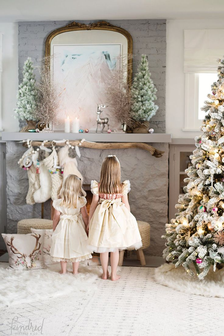 Stunning Christmas mantel - love the branch with stockings hanging