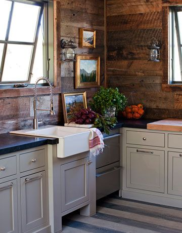 farmhouse sink, industrial faucet, painted stripe floors, nautical sconces, and reclaimed wood walls.