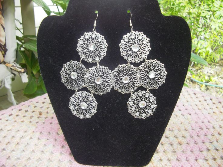 Large Silver Tone Flower/snowflake with Rhinestones in each centre.