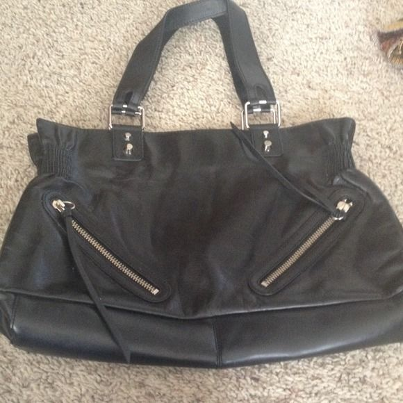 Banana republic tote Black with two front zips with fringe. Minor scuffs. Never used. Slightly mis-shaped from being in a box. 10x17 9in straps . No trades Banana Republic Bags Totes