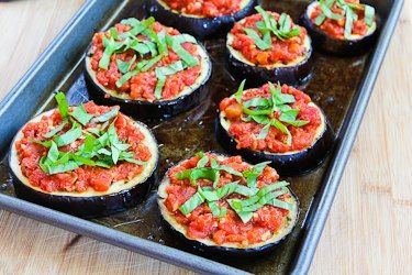 Recipe for Julia Child's Eggplant Pizzas. I made a few different variations of this pizza. The toppings were sautéed spinach, caramelized onions, roasted red peppers, shrimp, homemade pesto, and homemade tomato sauce. I used diff combinations for each. They were really amazing and since I did the whole 30 I omitted the cheese. #glutenfree #whole30 #cleaneating