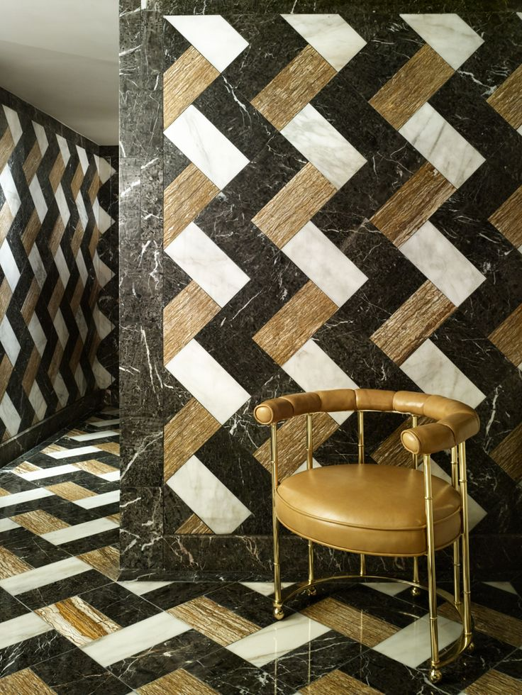 Brown, Black, and White Vertical Chevron Pattern Tiles. Marble and Quartz, by Kelly Wearstler Interior Design.