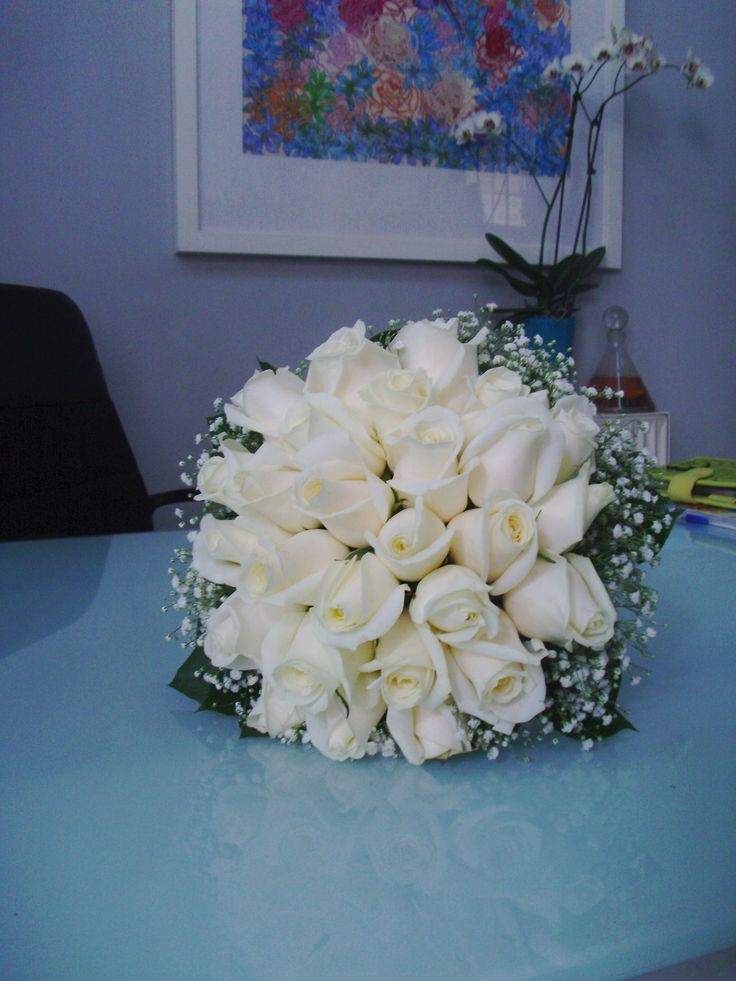 Moustakas flowers-Wedding bouquet with white roses #bridalbouquet #classicbridalbouquet #weddingwhiteroses #roses