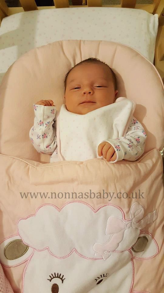 """Baby Skyla is a gorgeous little lady, all snug and comfy in her Cotton Candy Nap Mat. Grandma Marie told us """"Hi Nonna would just like to share a picture of my Granddaughter Skyla, she was born on the 4th April and she is now 3 weeks old today and loving her Nap Mat, just like her cousin Taliah did who is now 7 months old."""" Thank you to mummy Dani for allowing us to post this cute photo, which grandma Marie sent us. :-) • Find out more about Baby Nap Mats…"""