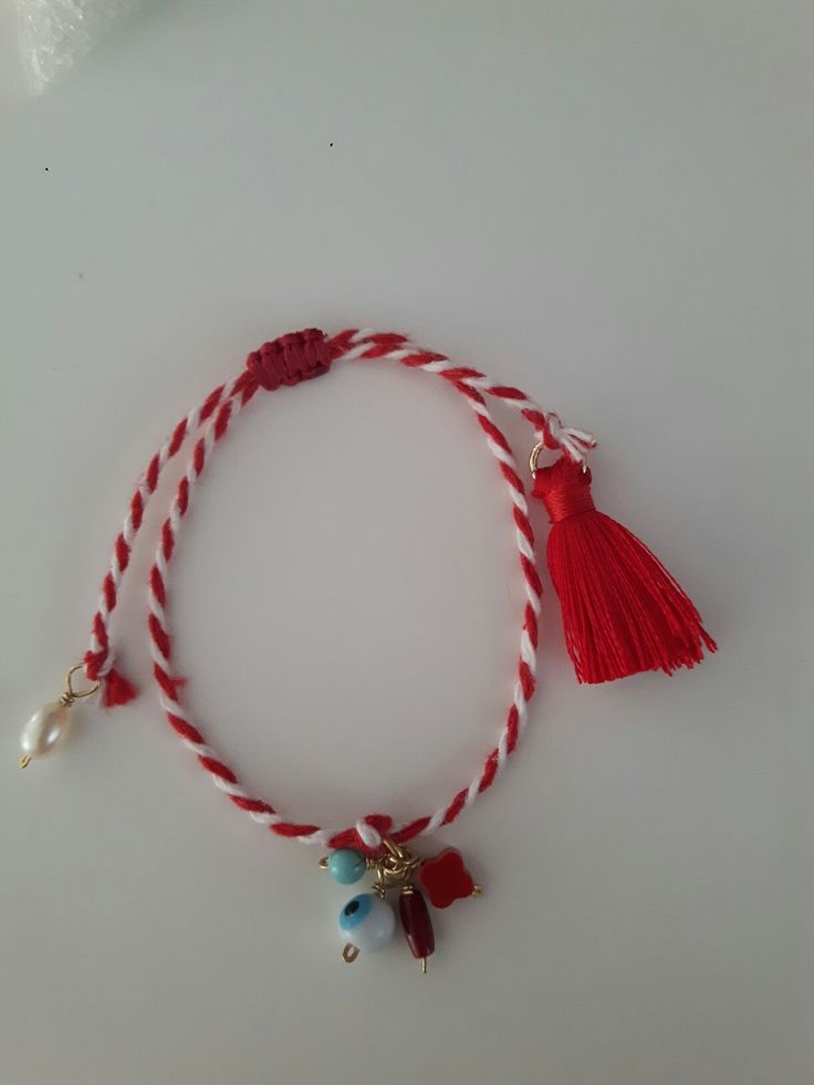 March bracelet, with silver 925, pearl, turquoise, coral, evil eye and a red tassel.