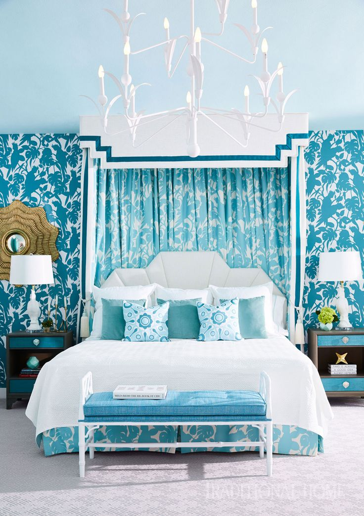 This dreamy blue oasis complements the pool views the bedroom affords. The custom bed canopy is garnished with teal tiebacks from Pyar & Co. - Photo: Victoria Pearson / Design: Allison Mattison and Liza Sharp, Trellis Home Design