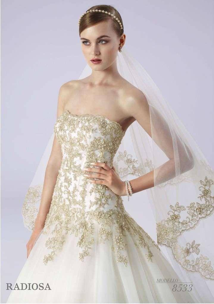 Abiti da sposa bianco e oro