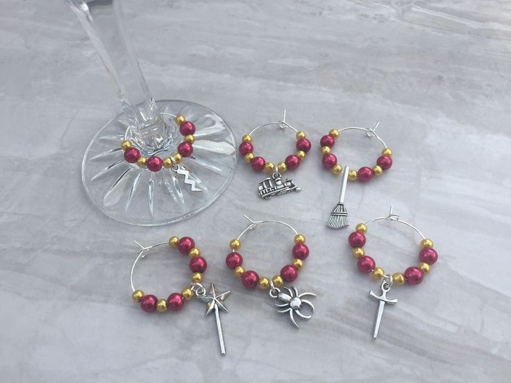 A personal favourite from my Etsy shop https://www.etsy.com/uk/listing/258985461/wizard-wine-glass-charms-hostess-gift