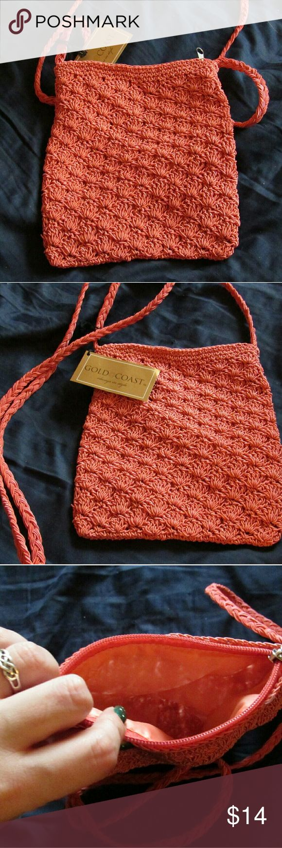 Gold Coast knitted cross body bag I had a friend who gave this to me. I never used it. Good for a vacation when you don't want to carry a large purse or any other times you don't want to drag around luggage!  It's coral color.  Not my style maybe it's yours! Gold coast Bags Crossbody Bags