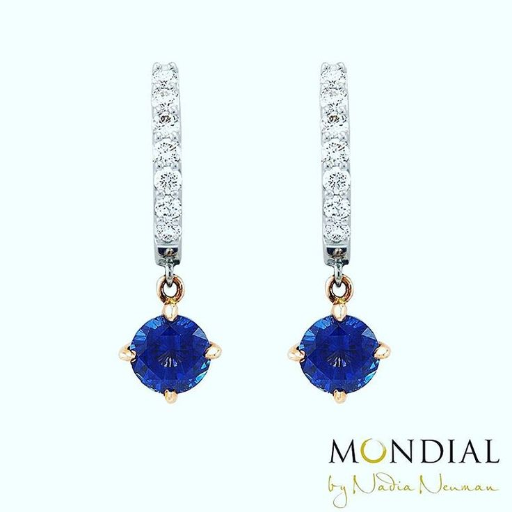 Sapphire earrings with small white hanging diamonds creating a sense of depth and mystery to the woman wearing them. #mondialbynadia #sapphire #designerjewelry