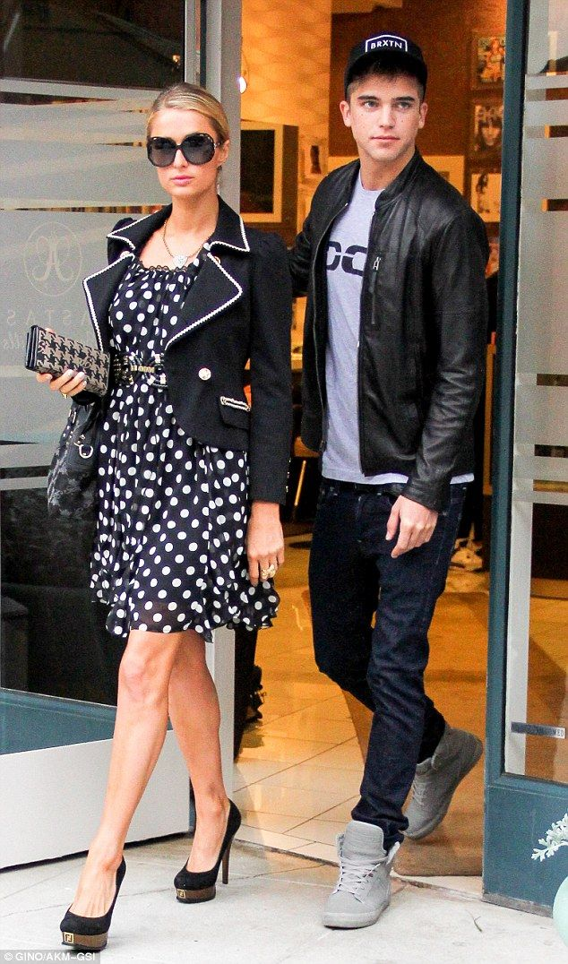 Puppy love: River Viiperi, 21, protectively held onto girlfriend Paris Hilton, 31, as they left Anastasia Salon in Beverly Hills on Thursday