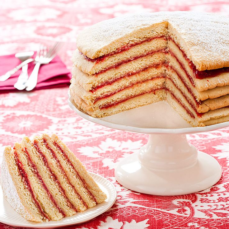 This traditional Appalachian Strawberry Stack Cake recipe combines thin, spiced molasses rounds with stewed dried apples. For a  fresh summer spin we swapped strawberries for the apples.