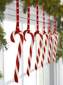 Christmas Windows - simple idea of hanging candy canes with ribbon.