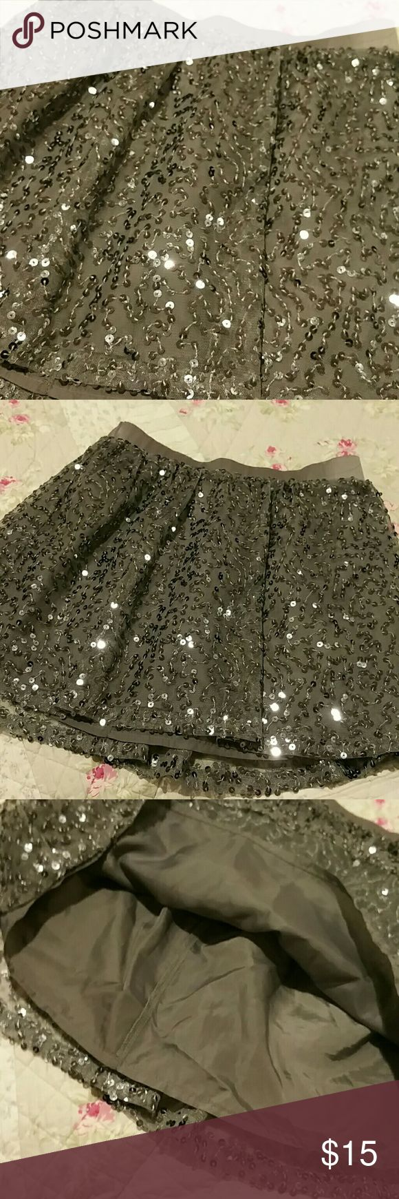 Silver sequins skirt 7/ 8 This is a silver sequin skirt fully lined and satin elastic waistband any little girl would feel special wearing this Candie's Bottoms Skirts