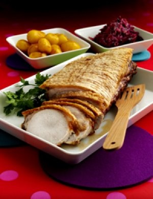 Pork roast. The traditional Danish christmas dinner served with white and sugar browned potatoes, brown gravy and warm, pickled red cabbage.