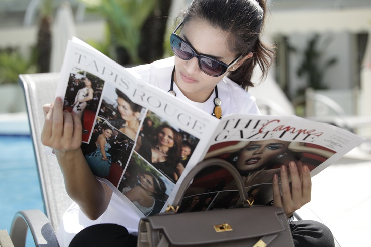 Dian Sastrowardoyo is reading Cannes Gazette at Martinez Hotel, Cannes Film Festival 2012