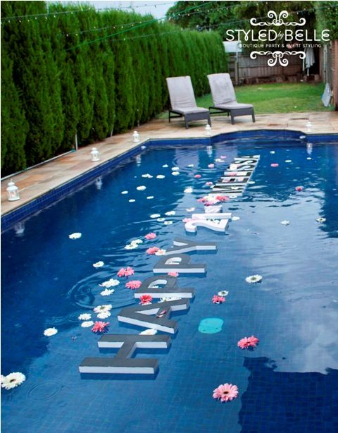 LOVE the styrofoam lettering floating in the pool