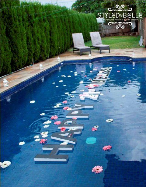 LOVE the styrofoam lettering floating in the pool - Genius!