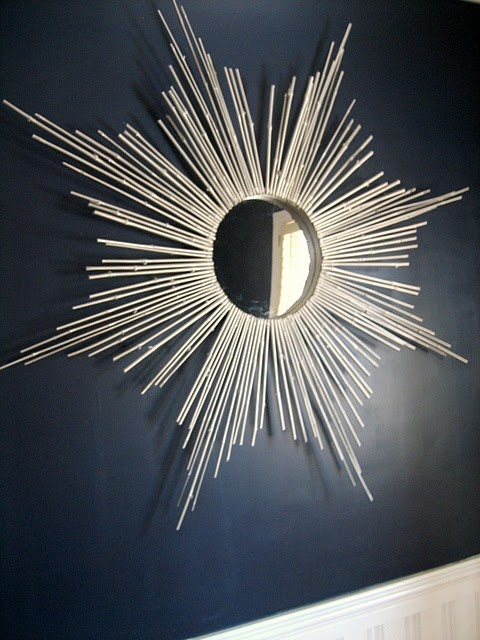 DIY Sunburst mirror from Ten June.  It turned out beautifully - until a bit of pressure was applied to the bamboo, & most of them popped off.  If it had stayed on the wall permanently (& we'd been a bit more careful) it would have been fine, though.