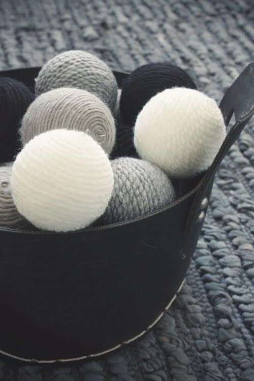 DIY - Decoration using the following materials:  wool yarn, styrofoam ball, glue, brush and wire to hang if desired.