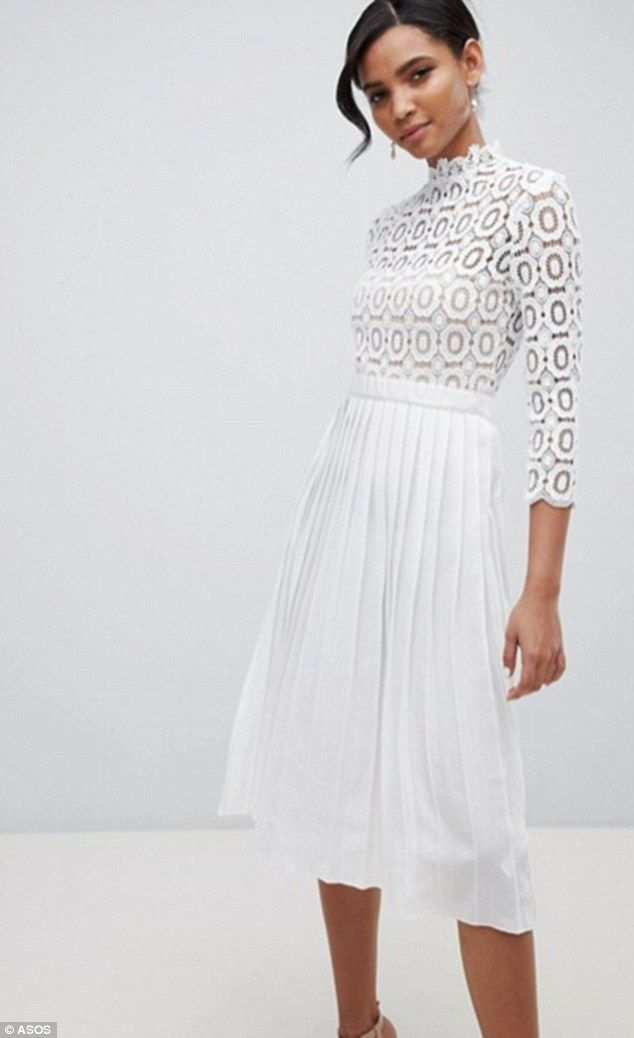 9916debd2aa28 Little Mistress has launched a white dress with a crochet bodice and pleated  skirt that's .