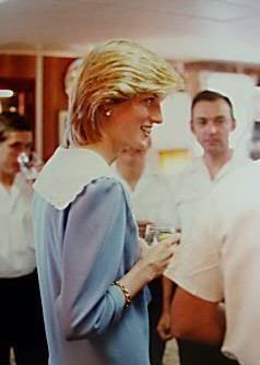 June 27, 1983: Princess Diana speaking with Royal Yachtsmen in the Unwinding Room on the royal yacht Britannia