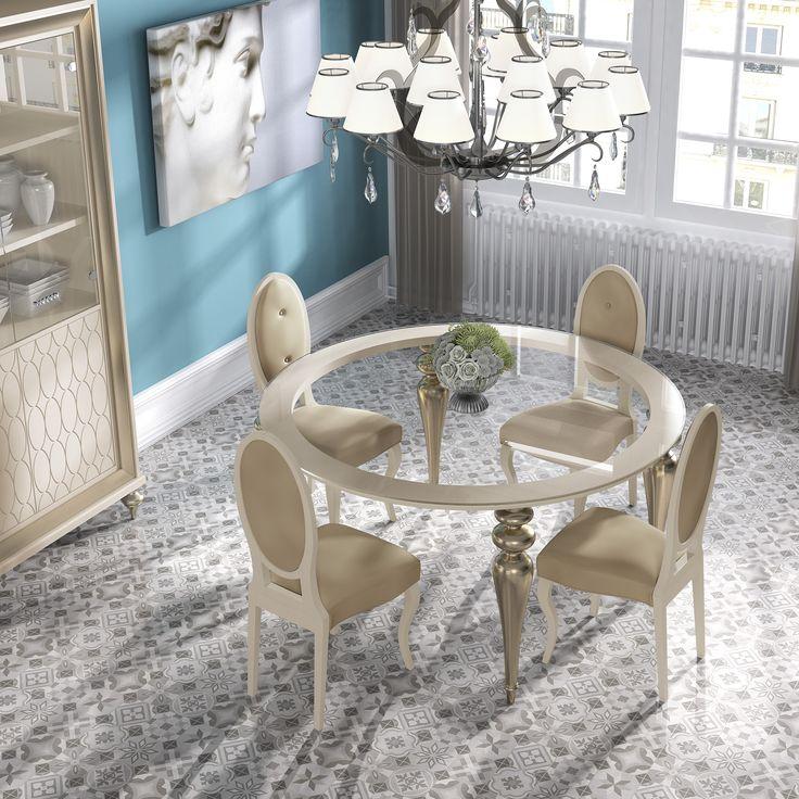 Elegante juego de mesa de cristal redonda con sillas tapizadas. Los detalles dorados de las patas torneadas y los colores suaves y cálidos de las sillas, hacen de esta composición un rincón exclusivo y muy chic. http://www.aristamobiliario.es/
