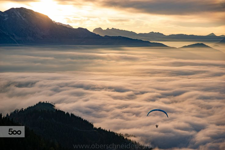"""Magical Sunset Paragliding session above the Clouds near Salzburg, Austria.  Image available for licensing.  See more of my work here:  <a href=""""http://www.oberschneider.com"""">www.oberschneider.com</a>  Facebook: <a href=""""http://www.facebook.com/Christoph.Oberschneider.Photography"""">Christoph Oberschneider Photography</a> follow me on <a href=""""http://instagram.com/coberschneider"""">Instagram</a>"""